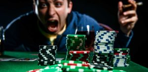 What is the difference between problem gambling and pathological gambling?